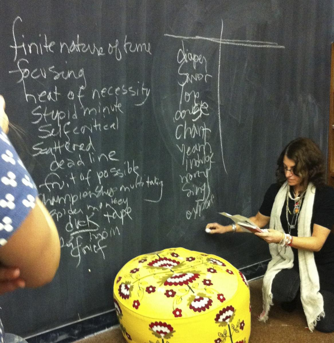 Lori Landau compiling the communal mums' poem at the Museum of Motherhood