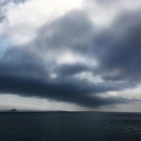 Cloudy sky over dark sea