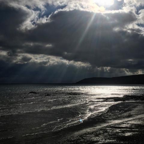 A dark sky above the sea