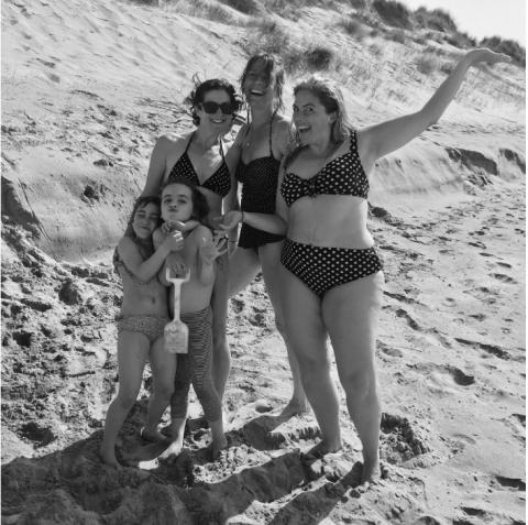 happy friends in bikinis